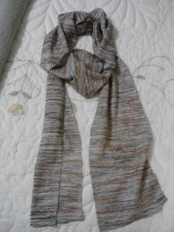 Super easy no-sew scarf. Bought some slinky sweater knit material on clearance and cut into long strips. With use, a subtle fray develops on the edges, which I think gives it a nice touch.