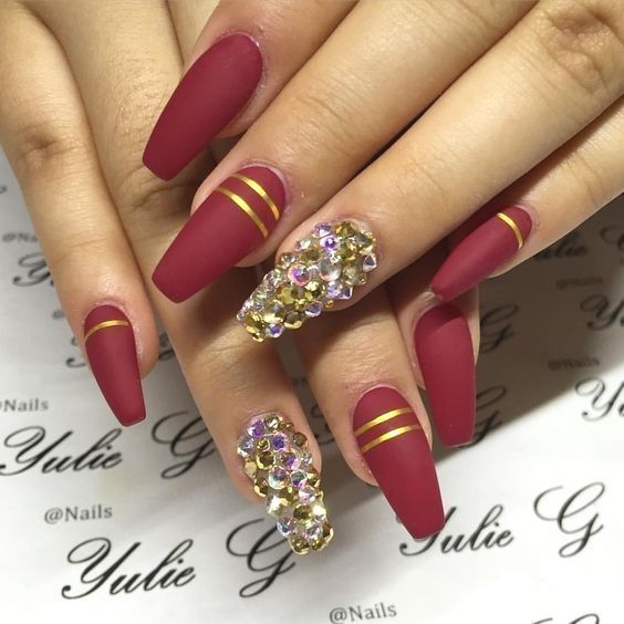 Burgundy Nails With Gold Line