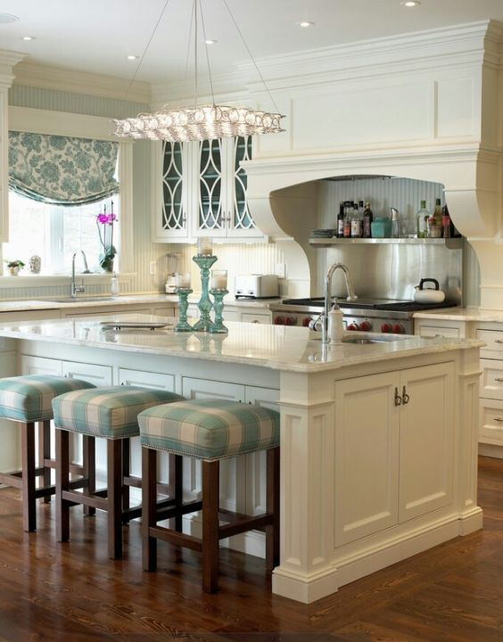 love the island; cabinets on both sides for storage; end detail looks like 'Furniture'; stools for seating; would want wood countertop: