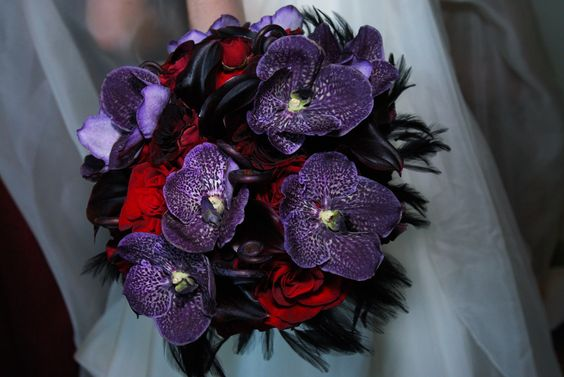 Purple and red bridal bouquet featuring vanda orchids.  www.helenolivia.com