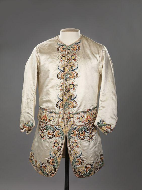 Sleeved waistcoat, 1760-1780. Cream silk satin embroidered with coloured silk thread.