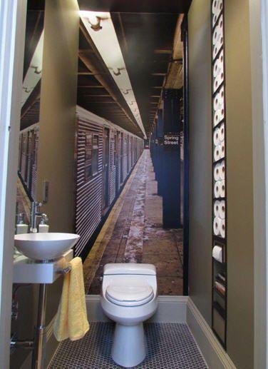 Cool powder room bath room {LOVE the photo wallpaper of the train platform}