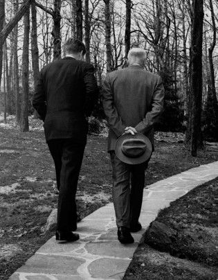 April 22, 1961    This Pulitzer Prize-winning photo shows President John F. Kennedy, left, and former president Dwight D. Eisenhower as they walk along a path at Camp David, where the two met to discuss the Bay of Pigs invasion.  Paul Vathis / AP