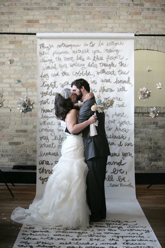 a handwritten ceremony backdrop with poems that were read by the mothers during the ceremony. such a lovely sentiment.  Photography by http://tammyhortonphotography.com
