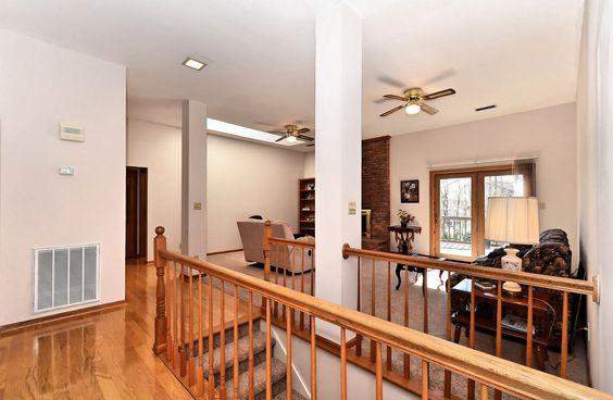 Modern Open Stairway Between Kitchen And Living Room
