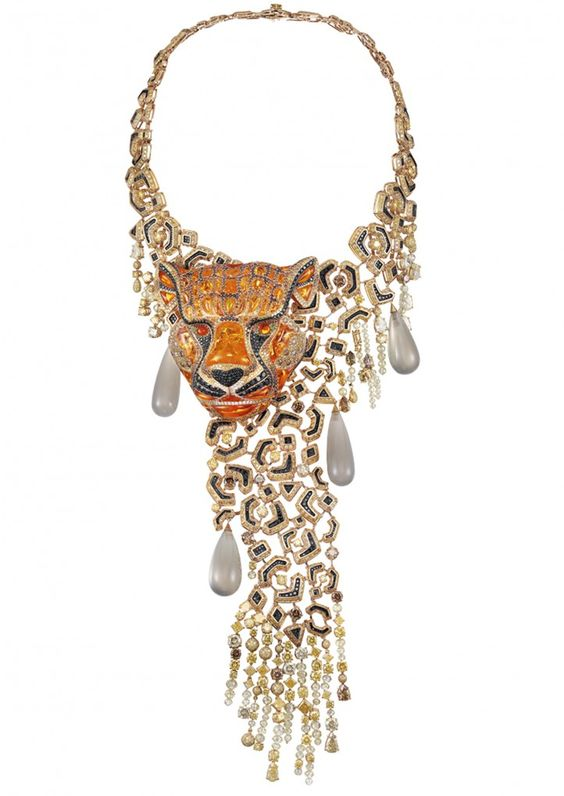 "A regal Tiger necklace from the Animal Collection. ""Tiger burning bright, in the forests of the night"" whose noble fire opal face peers out from a robe of coloured diamond and luminous grey moonstone drops."