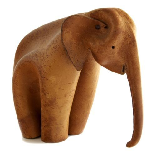 Deru Elephant. (1960s)  A German company called Deru made figures of various animals with an origami-like technique of crimping/sewing/riveting a single piece of leather.