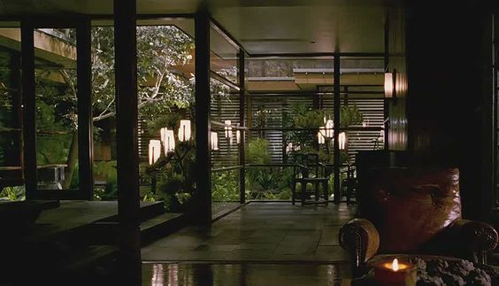"The dreamlike zen aviary at the centre of the house is complete with exotic greenery, extensive fishponds and soothing water features, from the movie ""when a stranger calls"":"