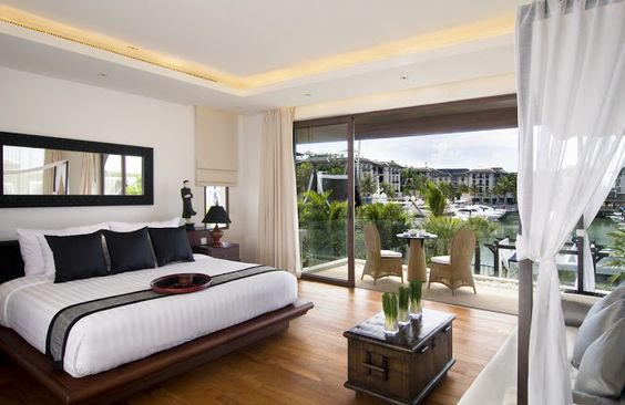 Picture of the modern bedroom looking out on the marina. More pictures of this house: http://www.worldofarchi.com/2013/02/amazing-villa-design-with-private-yacht.html