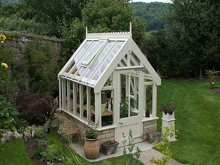 Wooden greenhouse on a stone dwarf wall near bath court for Tiny house with greenhouse