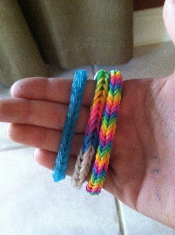 My rainbow loom creations. White and rainbow fishtail. Rainbow triple fishtail. Clear blue fishtail.