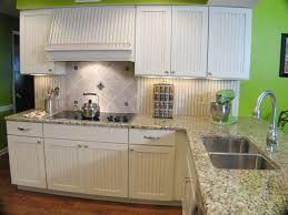 Image Result For White Vertical Slatted Kitchen Cabinet Doors Small Cottage Kitchen Cottage Kitchens Country Kitchen Backsplash