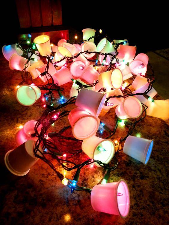 4.) Cut holes in the bottom of Nespresso pods and add them to a string of Christmas lights for a year-round decorative garland.: