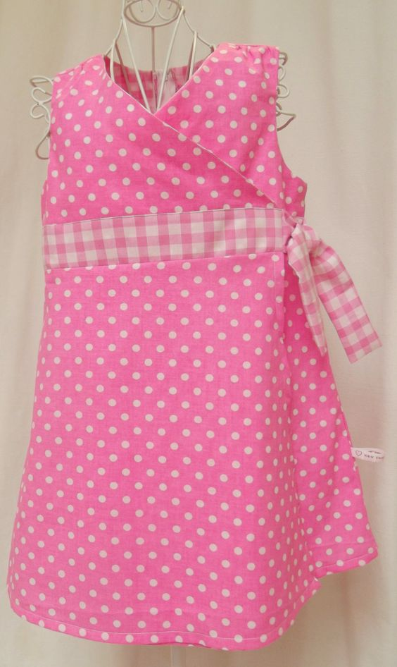 Bright pink polka dot crossover dress with gingham detail and tie, age 5 de la boutique AdventuresofXandV sur Etsy