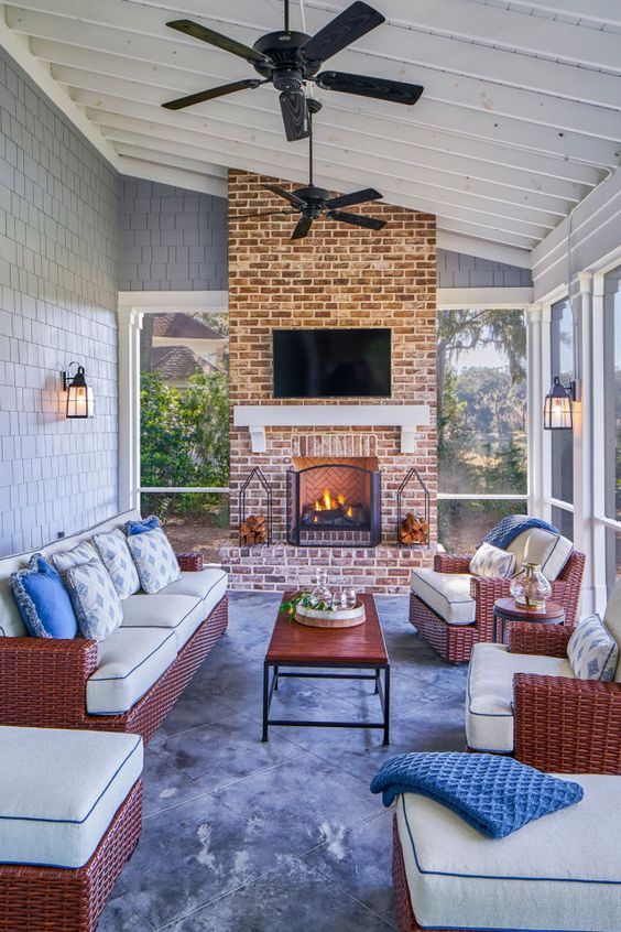 The covered screen porch looks like it was designed for sipping sweet tea on a hot summer day and roasting marshmallows over the fireplace at night.