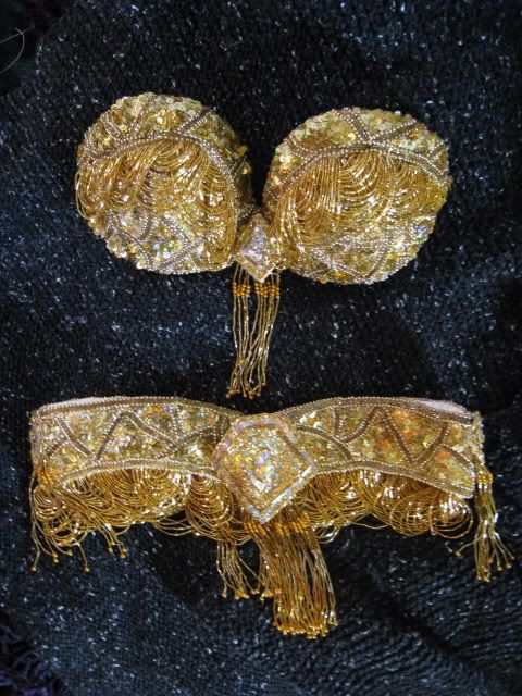 Incredibly detailed photo tutorial of creating a handmade bra and belt from a tacky old beaded dress from a thrift store.