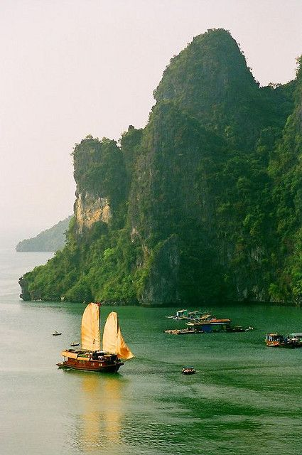 A junk with sails unfurled in Ha Long Bay, Vietnam (by josh-n).  One of the most beautiful spots on earth