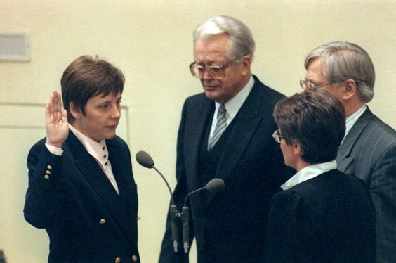 Merkel being sworn in to her first cabinet position, as minister for women and...