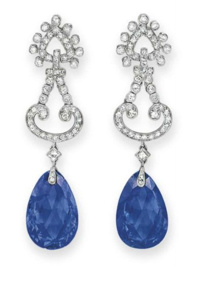 A PAIR OF SAPPHIRE AND DIAMOND EAR PENDANTS, BY CARTIER Each suspending a…
