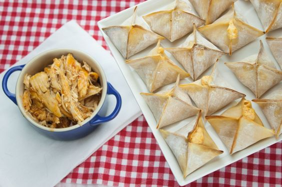 - just chicken, wing sauce and cream cheese baked in wonton wrappers ...