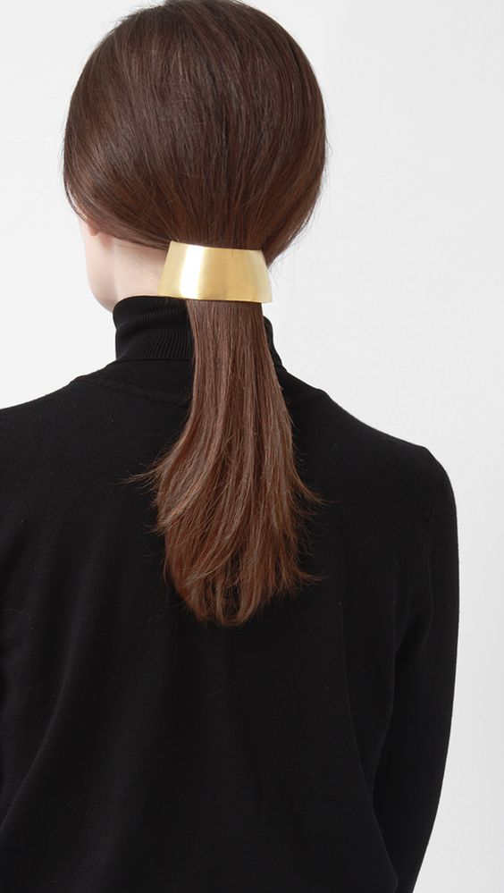 Hans Gold Barrette in large, rounded sculptural ponytail barrette in gold metal…
