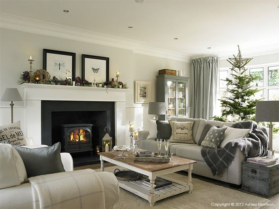 Pale grey paint above the white panelling is fired earth for Neutral front room ideas
