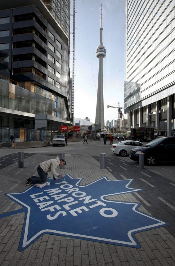 Toronto maple leaf hockey logo painted on the streets near the CN tower.