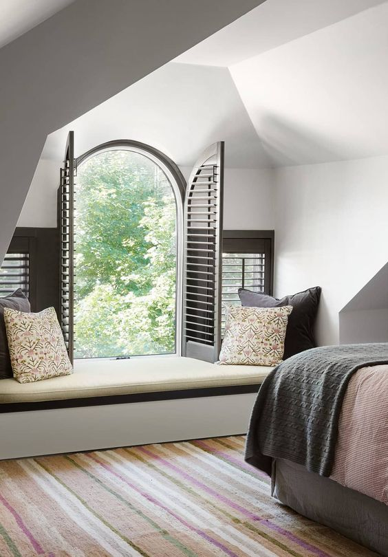 Color and Pattern for a Family Home. Arched window with shutters. Window seat.