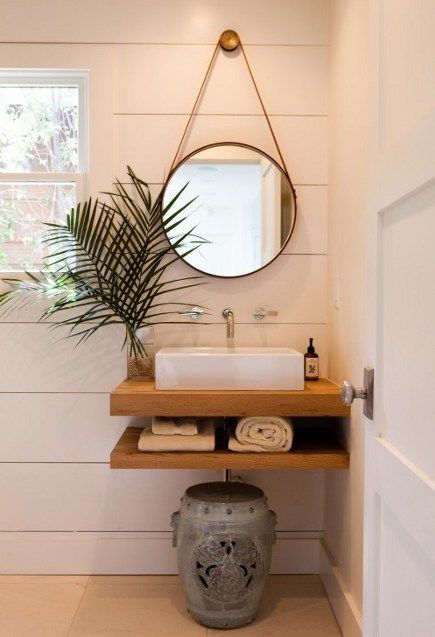 wall-mounted taps, hanging mirror, solid wood, neat sink.  Good for a powder room.