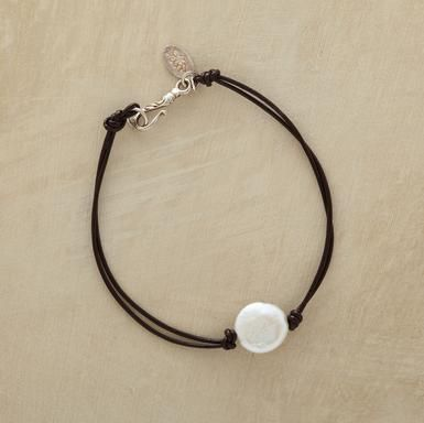 """Luminous as a gibbous moon, one cultured freshwater coin pearl glimmers on double leather strands. Sterling silver S-hook closure with lotus charm. Handmade in USA exclusively for Sundance. Approx. 7-1/2""""L."""