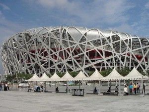 """Lahiji cites the Beijing Olympic Stadium as an example of """"spectacle,"""" a """" a mainstay of cities who seek a global city skyline and status."""" Read the article at: https://www.pinterest.com/pin/556757572664285412/."""