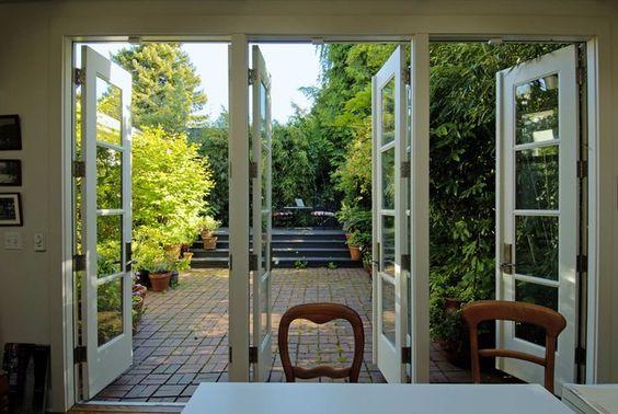 Doors open to a pretty garden