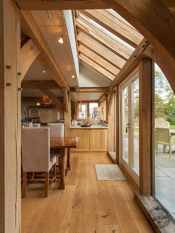 Oak Framed Kitchen Diner with Glazed Roof Panels and Timber Floor by Carpenter Oak Ltd