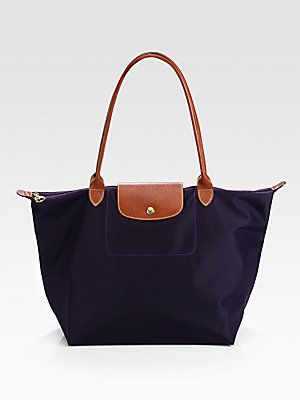 Work bag, school bag, everything bag! I got mine in dark green. Love it! I recommend finding one with black lining. The newer colors have white lining and it gets dirty quickly. Longchamp Le Pilage Large Tote.