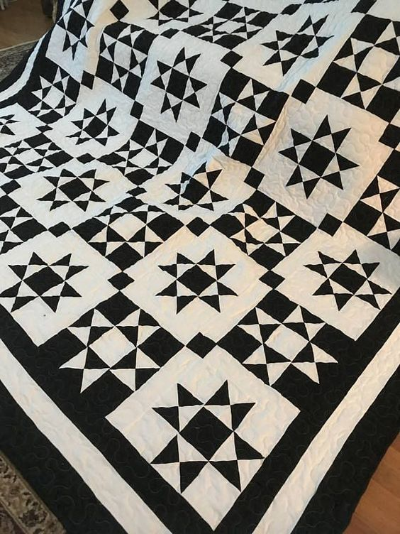 "Quilt Made to Order I am now booking May 2018 as a start date Ohio Star Black and White This quilt is even more beautiful in person!! I use Kona Cotton Black and Kona cotton White for the top of the quilt and the backing. It is queen size 90""x90"" The Star blocks are 13"" If you"