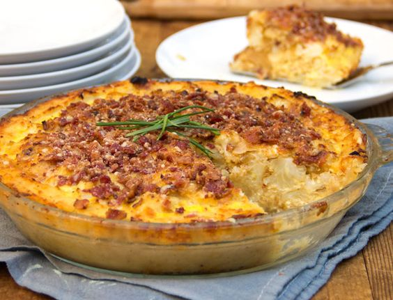 Potato-crusted Cauliflower Gruyere Pie topped with bacon-parmigiana crumbs or leave off the bacon for a stellar vegetarian main dish • A company-worthy savory pie • Panning the Globe
