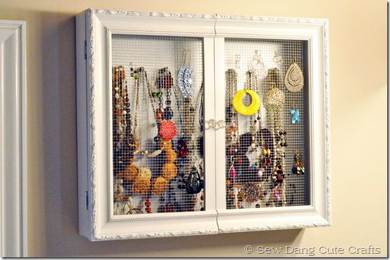 Wall cabinet for jewelry. Interesting idea to use a picture frame for the door.  Since I don't do earrings, could do a real picture frame with a picture in it, hide the jewelry?