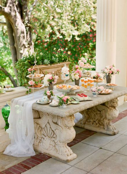 What a beautiful and shabby chic buffet display in this little outdoor space. Love it!
