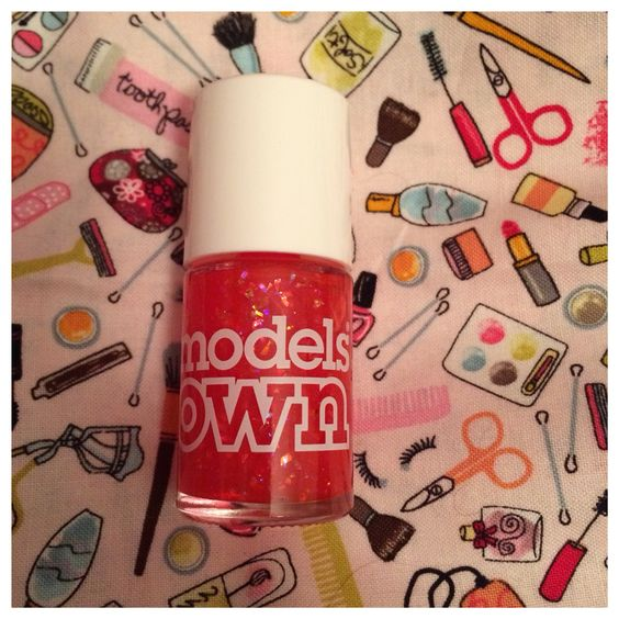 Models Own red glitter nail polish.