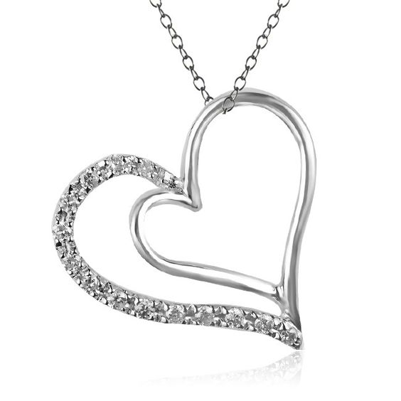 This pavé diamond heart pendant features 0.07 Carat T.W. of diamonds, which frame one side of a high-polished heart.