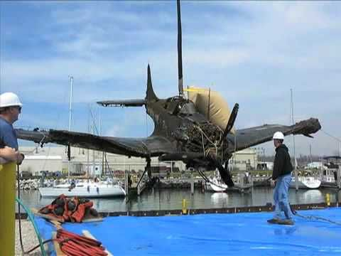 ▶ WWII-era bomber pulled from Lake Michigan - YouTube. Douglas SBD Dauntless.