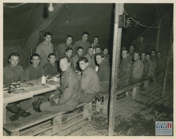Enlisted men seated for a meal at a long mess table inside a tent in Italy, circa 1944. | The Digital Collections of the National WWII Museu...