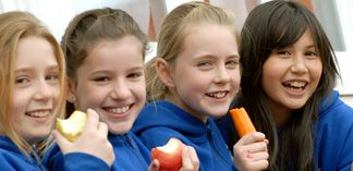 Students eating fruits and vegetables