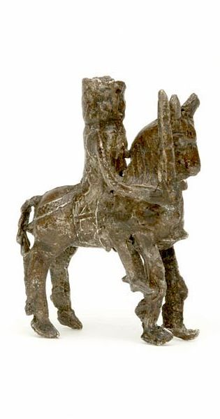 Toy figurine, about 1300, lead alloy -- This knight on horseback is the earliest hollow-cast pewter figure known in England, and is one of the earliest examples of a mass-produced medieval metal toy. The knight's panoply includes a hauberk (coat of mail) and he carries a sword in his right hand. The helm is missing. Stylistic features suggest a date of about 1300. Comparable figures have been found on the continent.