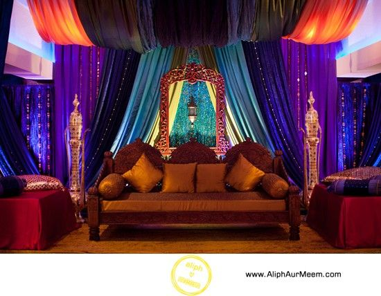 Sangeet decoration with original intense fabric colors for Auditorium stage decoration