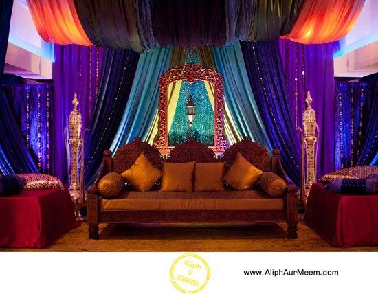 Sangeet decoration with original intense fabric colors for Auditorium stage decoration