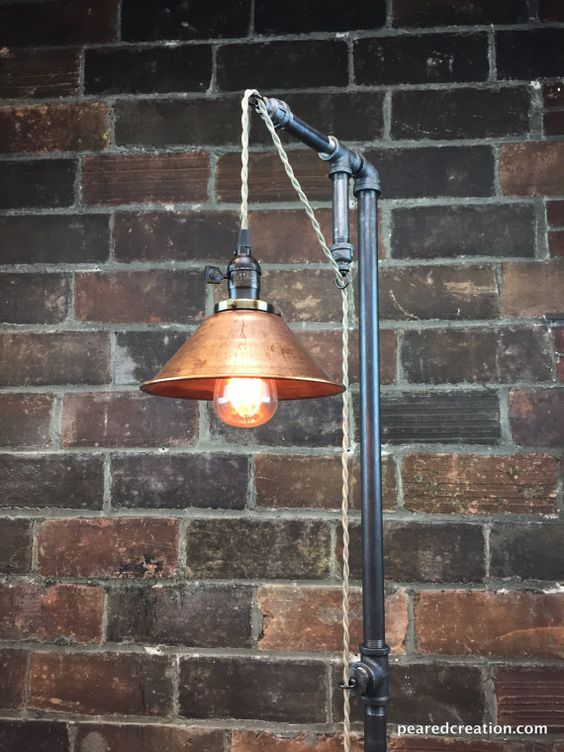 This industrial floor lamp was designed with versatility in mind. The fixture has a built in adjustable pendant that can be set to your desired