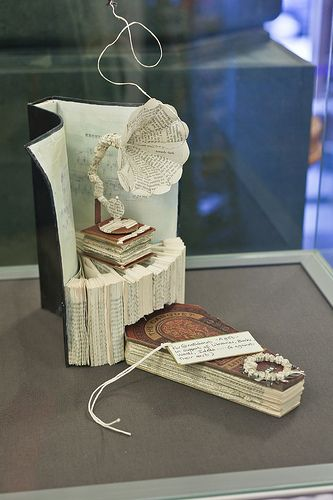 """Mysterious book sculptures appearing around Edinburgh """"in support of libraries, books, words, ideas."""" Pictured: sculpture left at the National Library of Scotland"""