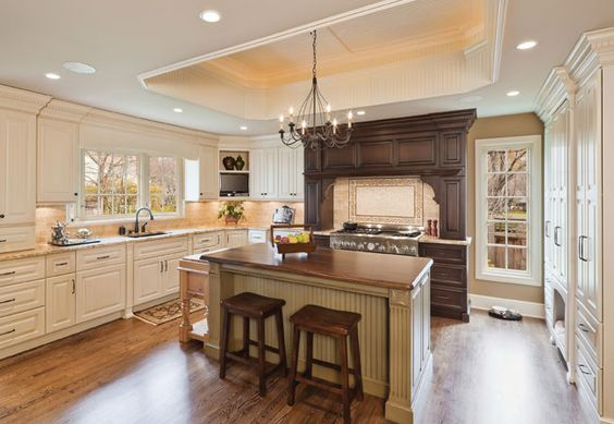 Clad mostly in cream colored cabinets this traditional for Kitchen cabinets kansas city