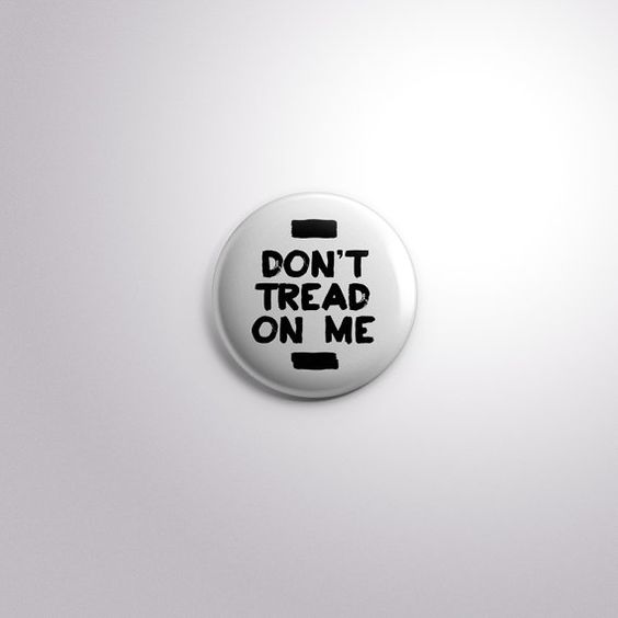 Don't tread on me white pinback button. From by EffinGovernment